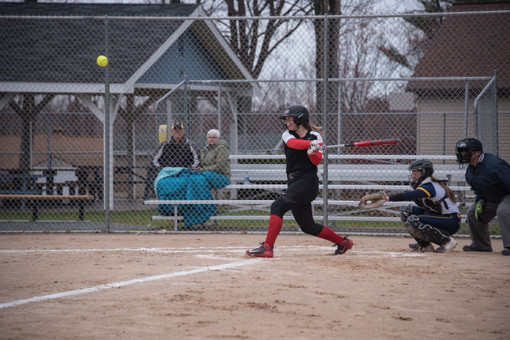 Marquette Redettes Softball player at bat.