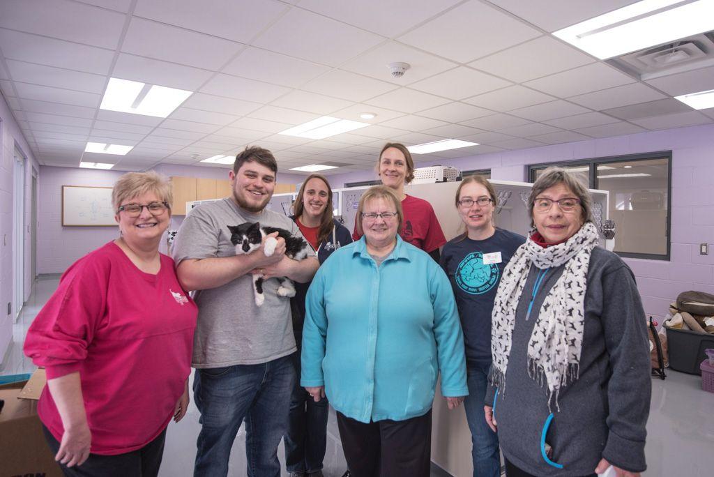Ann, DJ, Llyod (the cat), Lisa, Reva, Julie, Adda, and Lynn at the new animal shelter.