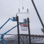 Lowering the beam into place.