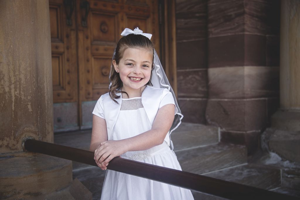 Portraiture for a girl during First Communion at St. Peter Cathedral.