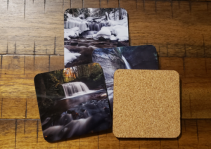 The coasters have a cork back for extra grip on slick surfaces.